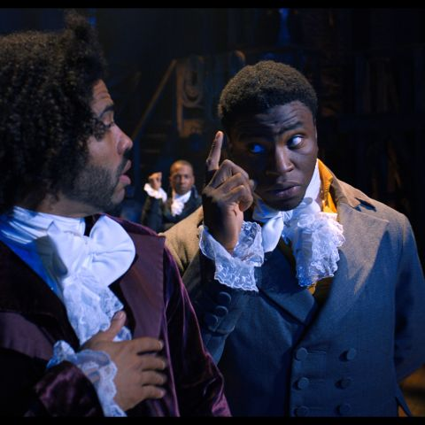 Daveed Diggs is Thomas Jefferson and Okieriete Onaodowan is James Madison in HAMILTON, the filmed version of the original Broadway production.