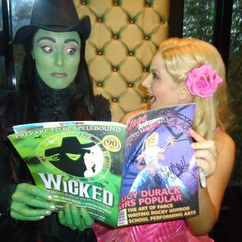 Elphaba (Jemma Rix) and Glinda (Lucy Durack) check out Stage Whispers.